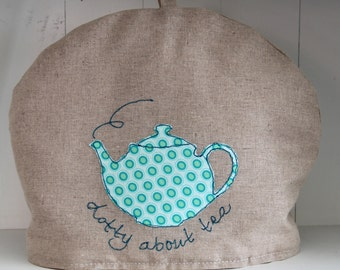 Applique and freestyle machine embroidery tea cosy