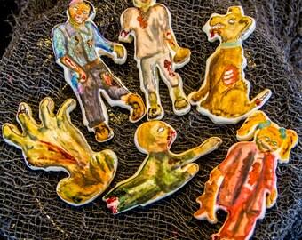 One dozen hand painted zombie cookies
