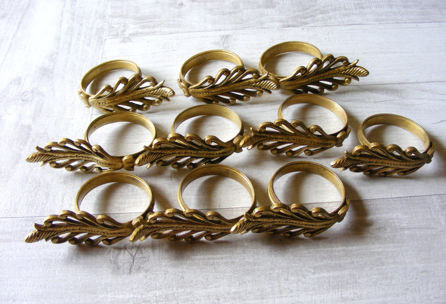 five antique bronze curtain ringsin the shape of