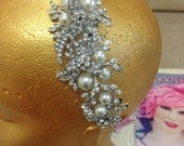Stunning crystal headband with large faux pearls and clear crystals on a sparkly silver tone finish