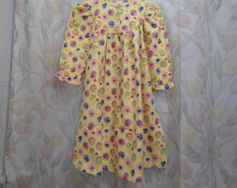 Size 3 girls Night Gown with multi colored tea cups on yellow backgrown.