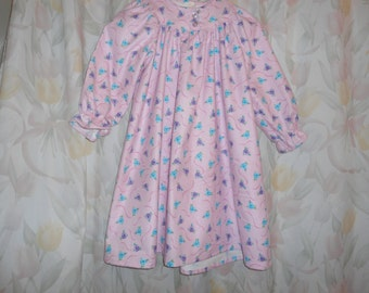 Size 6 Girls Gown with blue and purple flowers on pink background