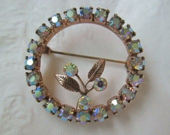 Aurora Borealis Circle Brooch With An AB Flower