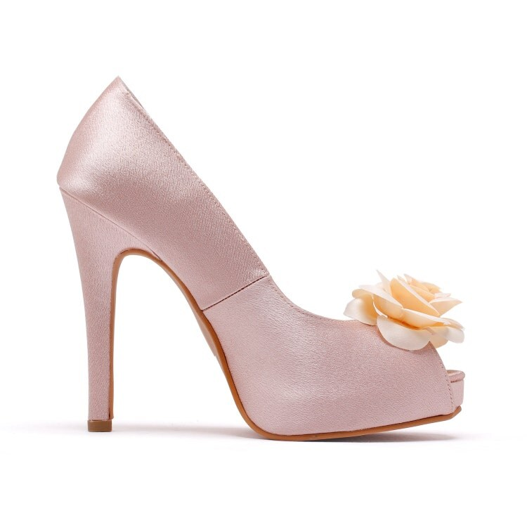 blush pink wedding shoes with flower by