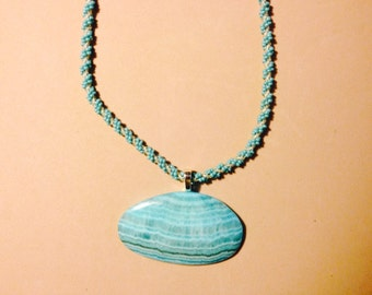 Hand beaded necklace with turquoise blue agate stone pendant.