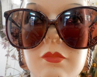 A pair of Serangeti eyewear from the 1980s in moiled brown