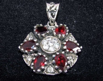 sterling silver gemstone pendant with a red garnet and white topaz marked 925 (GP21)