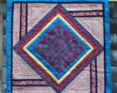 Square table topper with Hmong-style embroidery center