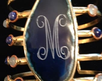 Gorgeous engraved gold-toned bracelet with navy, blue and clear