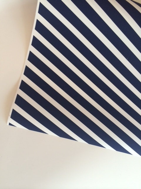 navy wrapping paper Our nautical wrapping paper set includes four designs the first design features a simple sailor's knot graphic in teal and navy with a white background next is a salmon colored paper with a crisp white anchor pattern.