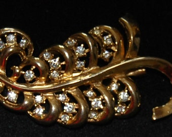 signed coro brooch