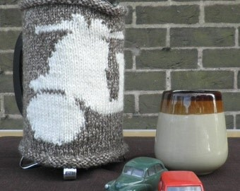 Hand-knitted scooter cafetiere french press hug in coffee and cream