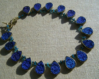 Marie-Josee's teal necklace