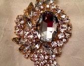 Large gold plated rhinestone brooch