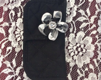 Black handmade eyeglass holder with a black and white flower and gllitz. Measures 3.25 x 7""