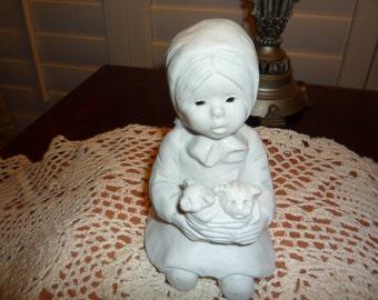 Sculpture of Little Girl Holding Kittens