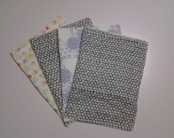 one set of four baby burp  cloths