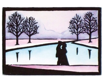 Valentines kiss print, handmade painted lino print of romantic couple by lake with winter trees, limited edition. Mounted, unframed.