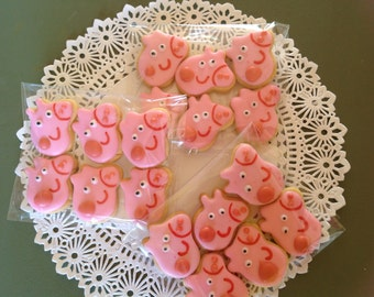 24 Mini Peppa Pig face iced cookies.