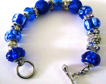 Blue and Silver Charm Bracelet with Bar Clasp