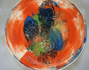 Ceramic plate, serving or display plate. Bright and bold colours with line drawing