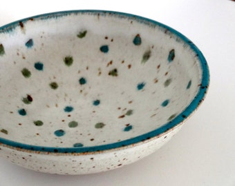 Hand thrown ceramic bowl with polka dots