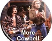 """More Cowbell. Item  FD-1018  - 1.25"""" or 2.25"""" inch Metal Pin back Button / Magnet or Mirror"""