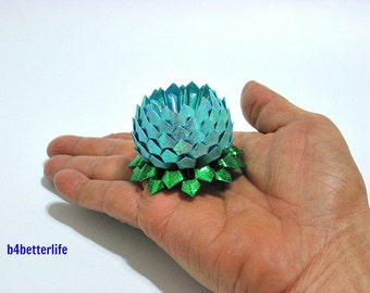 A piece of Mini Size Light Blue Color Origami Lotus. (RS paper series).