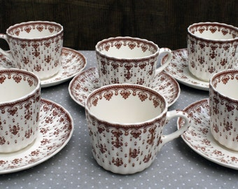 Collection of Spode Copeland Fleur de lis Brown Tea Cups and Saucers