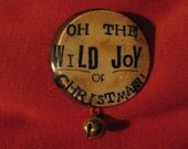 Oh the Wild Joy of Christmas glass dome pin with bell 1.5 inches in diameter     READY TO SHIP