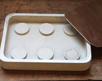 Concrete and steel soap dish.  Discontinued/Factory Second