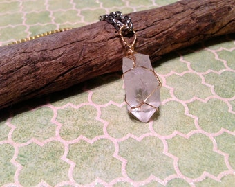 Quartz Crystal hangs on a multicolored chain