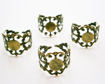 4 Antique Bronze plated brass filigree adjustable rings with glue pad.