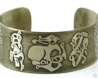 "1"" metal cuff with etched Viking knotwork animals design."