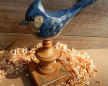 Hand Carved Bird Blue Jay carved from White Pine.  Perched on antiqued finial.
