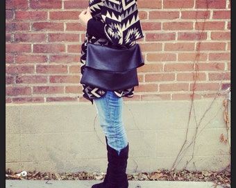 Crossbody and clutch in black leather