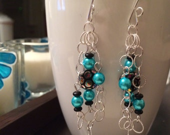handmade sterling silver and blue dangle earring with black peacock accent bead