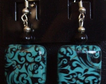 Black and tourquoise square bead earring.
