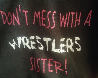 Don't mess with a wrestlers sister t-shirt