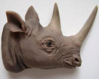 Hook-lipped rhino OOAK polymer clay pendant
