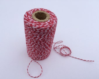 Red and white cotton bakers twine - approx 1mm thick. Price per continuous metre
