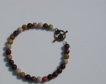Simply beaded Jasper stone bracelet of browns and tans with pretty Coppery toggle clasp.