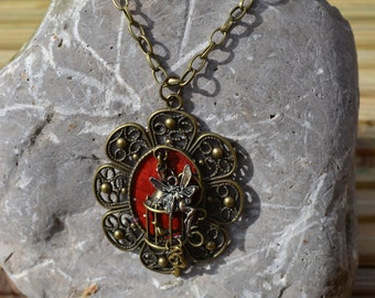 Fairy lets the bird out of the cage pendant necklace