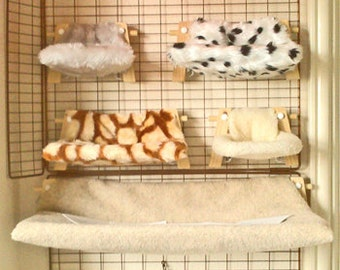 Beautiful Faux Fur Hammocks for Smaller Pets ( price includes cage hooks ). From