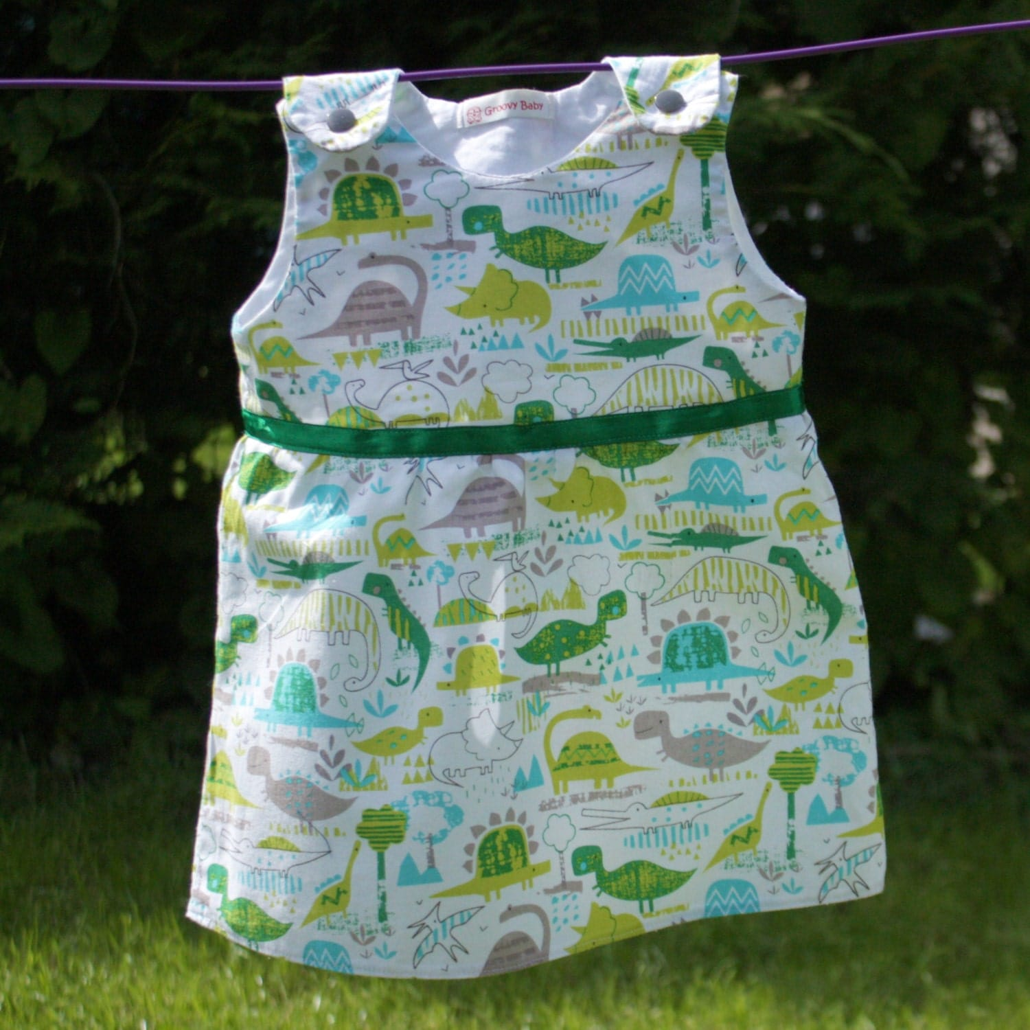 Baby girl 39 s dress in cute dinosaur fabric by for Cute baby fabric