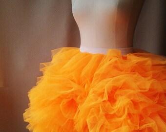 Bright orange tutu, Alice in Wonderland.