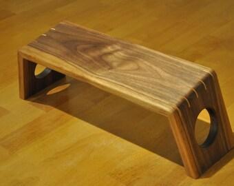 Walnut kneeling bench for mindfulness practice.