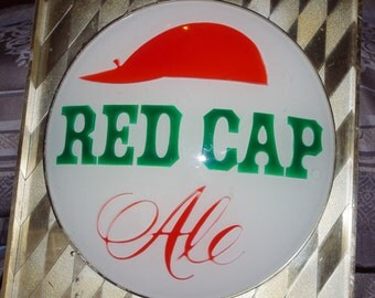 A 1950's Red Cap Sign Lamp