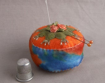 Handmade magnetic pincushion with embroidery, seed beads and ribbon roses.