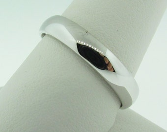 4 mm wide wedding band. White gold.